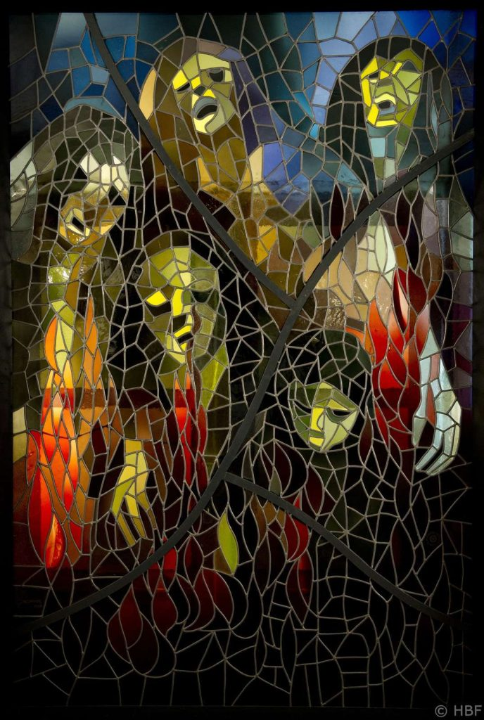 A stained glass window of abstract figures in pain, surrounded by fire.